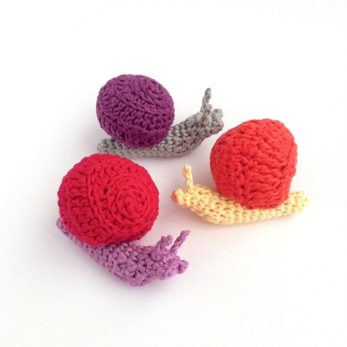Picture of brightly-coloured hand-crocheted snails by Little Conkers