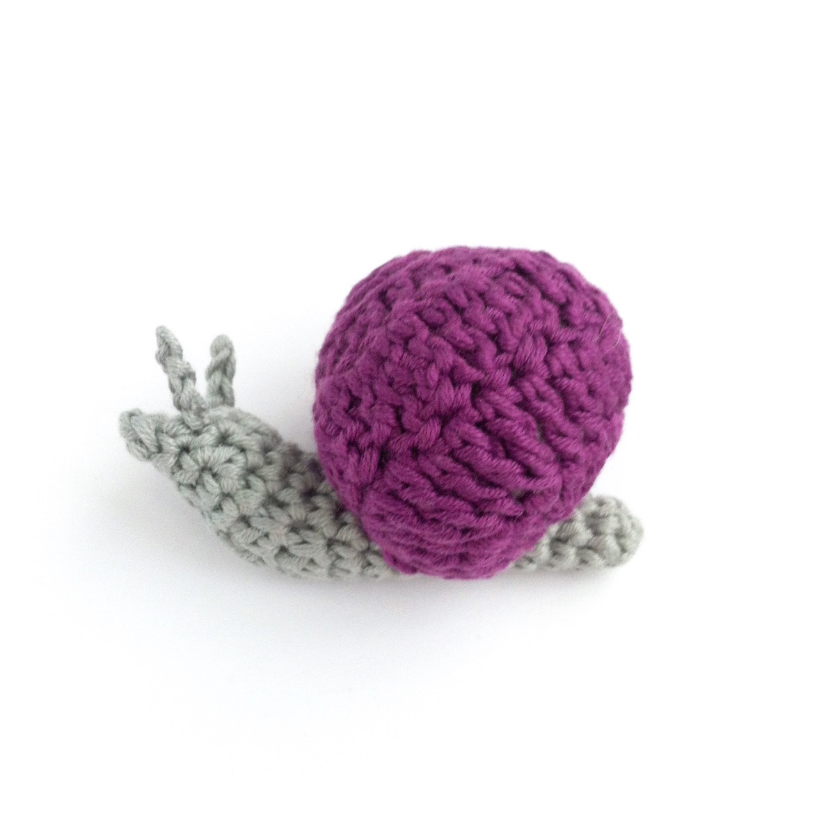 Picture of a brightly-coloured hand-crocheted snail by Little Conkers