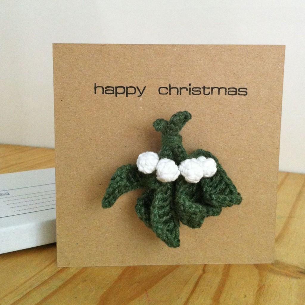 Mistletoe brooch on a greetings card