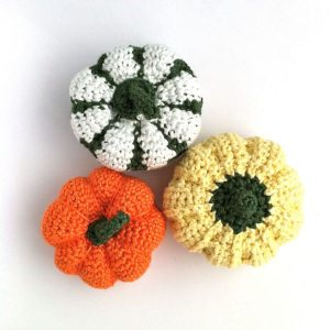 Picture of hand-crocheted pumpkins in a variety of colours