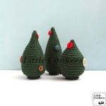 Miniature fir trees decorated with vintage buttons