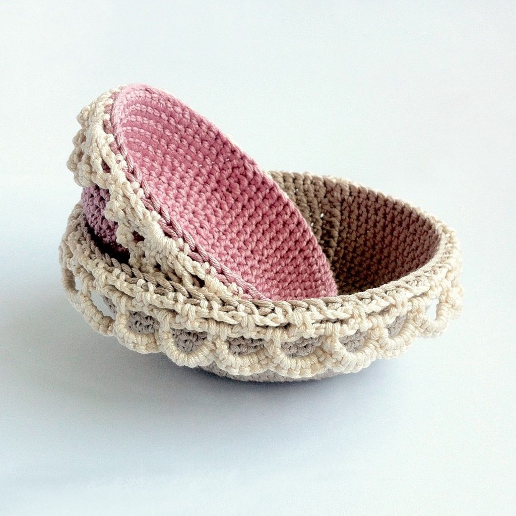 Two crocheted nesting bowls with lace edging