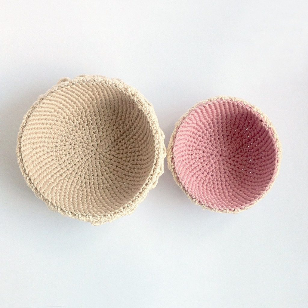 Two crocheted bowls with lace edging