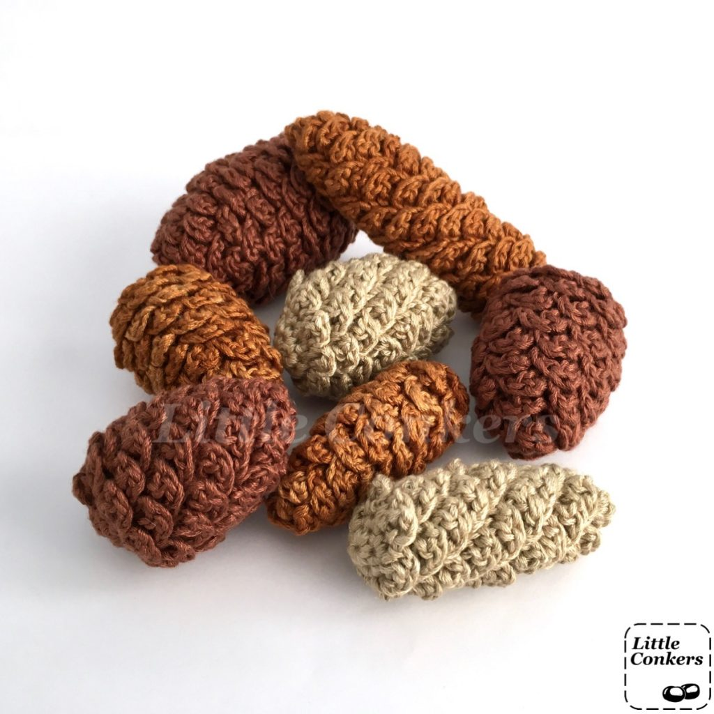 Collection of hand-crocheted pine cone ornaments