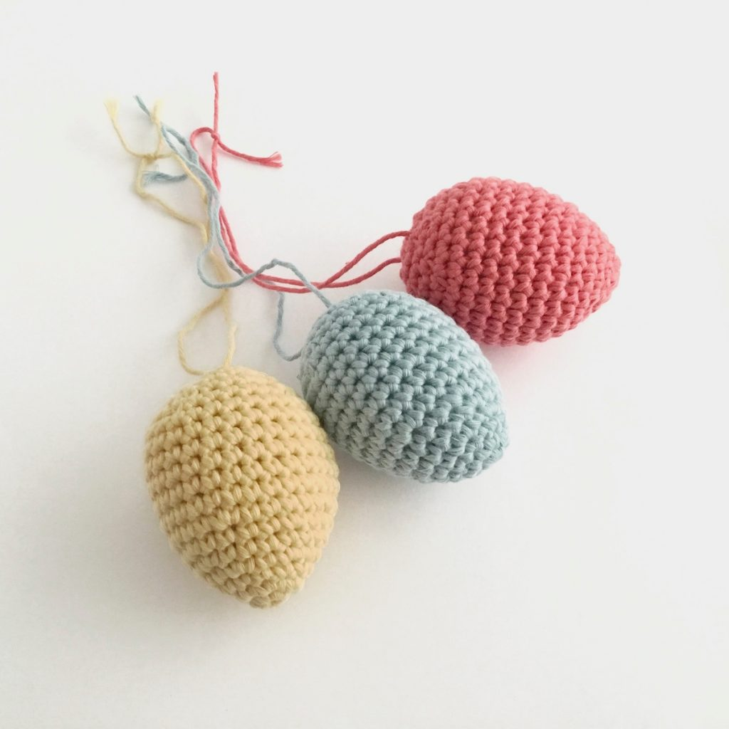 Crocheted egg ornaments in pastel colours